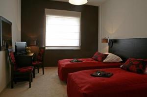 Łóżko lub łóżka w pokoju w obiekcie Hotel Altamira