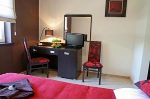 Telewizja i/lub zestaw kina domowego w obiekcie Hotel Altamira