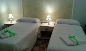 A bed or beds in a room at Primo Posto