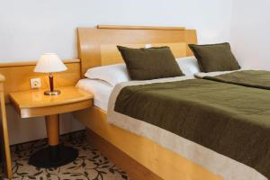 A bed or beds in a room at Terme Zrece - Hotel Vital
