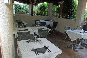 A restaurant or other place to eat at Hotel restaurant MARTINEZ