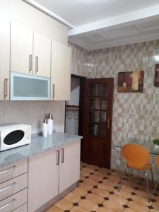 A kitchen or kitchenette at Nazaré Villa North Wave