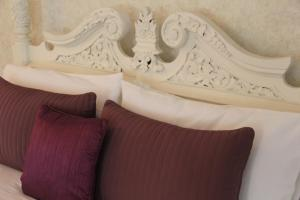 A bed or beds in a room at Northover Manor Hotel