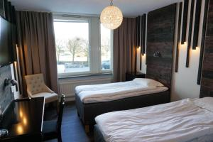 Postel nebo postele na pokoji v ubytování Havshotellet
