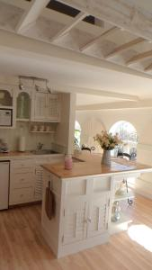 A kitchen or kitchenette at Star of the Sea B&B