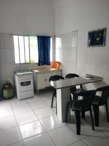 A kitchen or kitchenette at Apartamentos Águia Azul