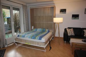 Ein Bett oder Betten in einem Zimmer der Unterkunft Ferienwohnung Sayn bei Koblenz