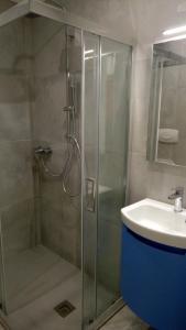 Koupelna v ubytování Hotel Catto Suisse