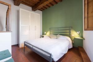 Cama o camas de una habitación en Flospirit Pilastri