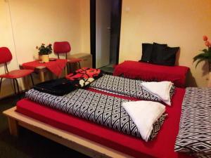 A bed or beds in a room at Táltos Vendégház