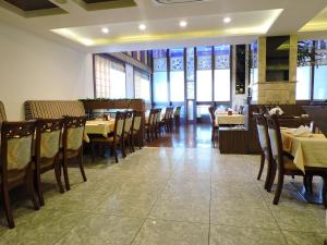 A restaurant or other place to eat at Hotel Devashish Haldwani