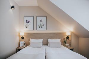 Łóżko lub łóżka w pokoju w obiekcie Tulipanowy Gościniec