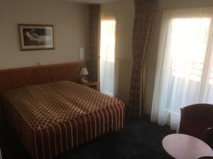 Un ou plusieurs lits dans un hébergement de l'établissement Hotel Meyer
