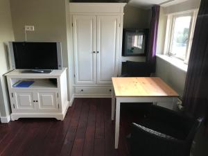 A television and/or entertainment center at Beachroom