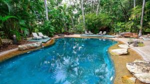 The swimming pool at or near 3 Bedroom Poinciana Lodge