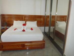 A bed or beds in a room at Jamelah Beach Guest House