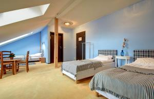 A bed or beds in a room at Aerohotel