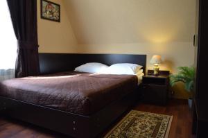Кровать или кровати в номере Комплекс Спасатель