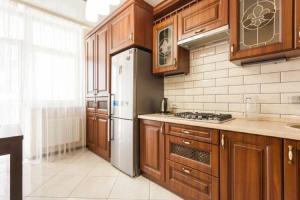 Кухня или мини-кухня в Apartment Prestige
