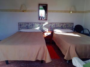 Een bed of bedden in een kamer bij Escandinavia