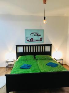 Ein Bett oder Betten in einem Zimmer der Unterkunft Apartments in the heart of Prague