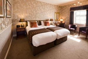 A bed or beds in a room at Best Western Plus Knights Hill Hotel & Spa