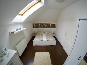 Un ou plusieurs lits dans un hébergement de l'établissement Ékszerdoboz A Budai Vár Alatt