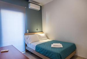 A bed or beds in a room at Lux Penthouse in City Center