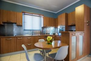A kitchen or kitchenette at Lux Penthouse in City Center