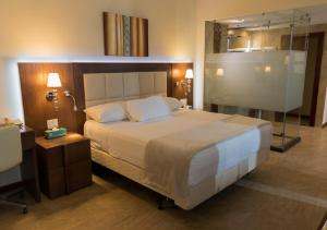A bed or beds in a room at Ramada by Wyndham Princess Georgetown
