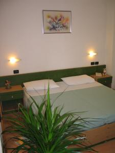 A bed or beds in a room at Hotel Levico