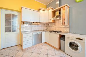 Kuchnia lub aneks kuchenny w obiekcie Grand Kaskada