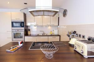 A kitchen or kitchenette at The Sands