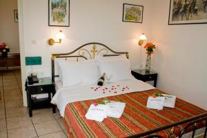 A bed or beds in a room at Aktaion City Hotel