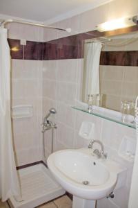 A bathroom at Aktaion City Hotel