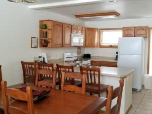 A kitchen or kitchenette at Alpenglow Vacation Rentals