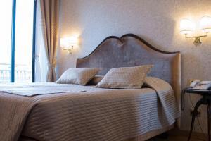Letto o letti in una camera di Hotel Europa