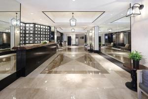 The lobby or reception area at Manila Lotus Hotel