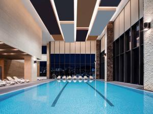 The swimming pool at or near Grand Mercure Ambassador Hotel and Residences Seoul Yongsan