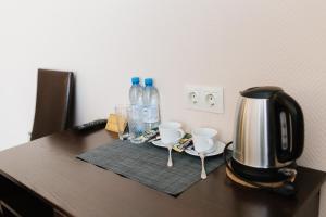 Принадлежности для чая и кофе в Hotel Palma