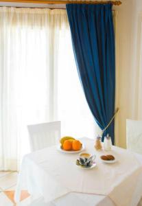Ένα ή περισσότερα κρεβάτια σε δωμάτιο στο Ξενοδοχείο Νιόβη