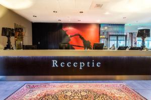 The lobby or reception area at Hampshire Hotel - Delft Centre