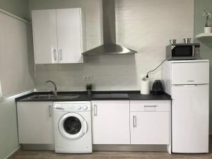 Una cocina o zona de cocina en Apartamento Pueblo Sherry