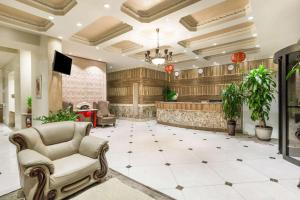 The lobby or reception area at Ramada by Wyndham Flushing Queens
