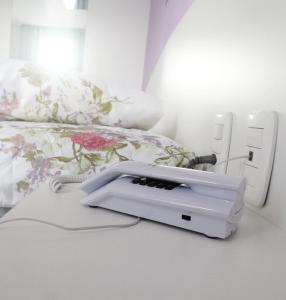 Cama ou camas em um quarto em Hotel Farrapos