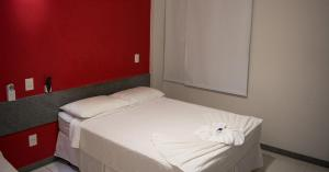 A bed or beds in a room at Hotel Marquetti