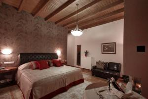 A bed or beds in a room at Methexis Boutique Hotel