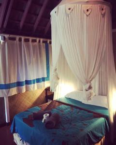 Cama ou camas em um quarto em Punatea Village
