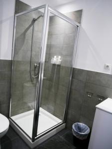 Ett badrum på Perla Seven Apartments and Rooms