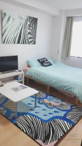 A bed or beds in a room at Tomiya